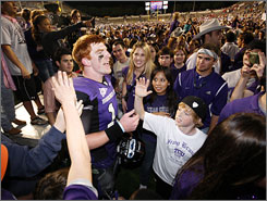 TCU quarterback Andy Dalton celebrates with fans after the Horned Frogs' offense racked up 549 yards in their 55-28 romp of then-No. 14 Utah.