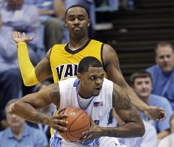 North Carolina's Will Graves is guarded by Valparaiso's Brandon McPherson during the teams' game in Chapel Hill, N.C. Sunday. No. 4 North Carolina won 88-77.