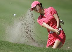 Michelle Wie blasts from the sand on the third hole Sunday on her way to victory in the Lorena Ochoa Invitational in Guadalajara, Mexico. It was Wie's first LPGA victory.