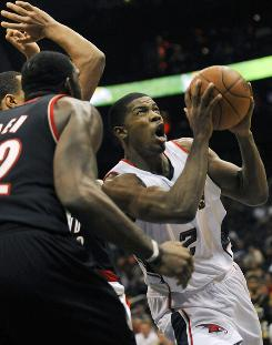 Atlanta Hawks guard Joe Johnson takes a shot against Portland Trail Blazers center Greg Oden during the fourth quarter of their game at Philips Arena in Atlanta. Johnson had 35 points for the night and lead the Hawks to a 99-95 win in overtime.