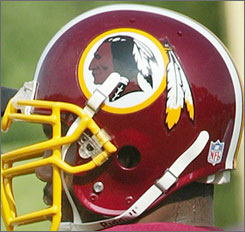 A Washington Redskins helmet showing the team logo in a 2003 photo.