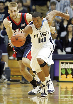 Villanova's Corey Fisher, right, heads up court with Penn's Larry Loughery trailing during the second half. Fisher scored 13 points as the Wildcats routed their Philadelphia rival 103-65.