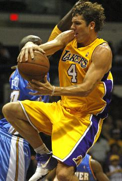 Los Angeles Lakers' Luke Walton, shown here in a preseason game against the Denver Nuggets on Oct. 23, has suffered a pinch nerve from a game against the New Orleans Hornets. Walton is expected to miss six weeks.