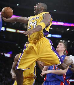 Los Angeles Lakers Kobe Bryant goes up to score past the Detroit Pistons' Jonas Jerebko during the first half of their game in Los Angeles Tuesday. Bryant scored at least 40 points for the 100th time in his career, and the Lakers won 106-93.