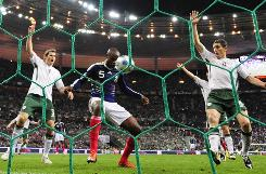 French defender William Gallas, center, scores against Ireland in extra time of their World Cup qualifying playoff Wednesday. The goal was set up after Thierry Henry apparently handled the ball but was not called for a foul by the officials.