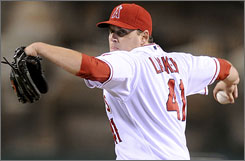 John Lackey was 11-8 with a 3.83 ERA for the Angels in 2009. A model of consistency, the right-hander has won 10 or more games in 7 of his 8 major league seasons. 