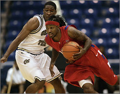 Dayton's guard London Warren, right, drives against Georgia Tech's guard Iman Shumpert.