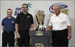 Mark Martin, left, and Jimmie Johnson, center, pose with Hendrick Motorsports owner Rick Hendrick Thursday at a news conference ahead of Sunday's NASCAR Sprint Cup season finale at Homestead-Miami Speedway.