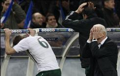 Ireland's coach Giovanni Trappatoni, front, reacts with player Glenn Whelan during their World Cup qualifying playoff second leg soccer match against France. A handball by French player Thierry Henry kept Ireland out of the World Cup.