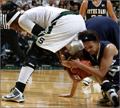 Ashley Barrow, right, battling Michigan State's Aisha Jefferson during the first half, hit a tiebreaking free throw with 10 seconds left to lift Notre Dame to victory.