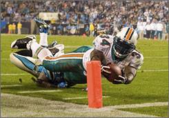 Ricky Williams scored three touchdowns in the Dolphins' 24-17 win at Carolina on Thursday.