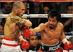 Miguel Cotto and Manny Pacquiao attracted $70 million in pay-per-view revenue for their welterweight title bout last Saturday.