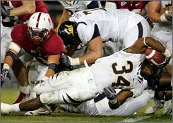 California's Shane Vereen (34) dives into the end zone during the Golden Bears' 34-28 win over Stanford. Vereen rushed for a career-high 193 on 42 carries and scored three touchdowns.