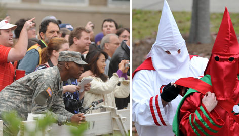 Fans jeer at members of the KKK holding a rally before the LSU-Mississippi football game on Saturday in Oxford, Miss.