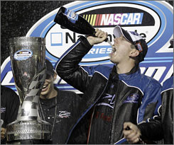 Kyle Busch drinks champagne after winning the Ford 300, the Nationwide Series' final race of the year, at Homestead-Miami Speedway. Earlier, Busch wrapped up the Nationwide Series title by starting the race.