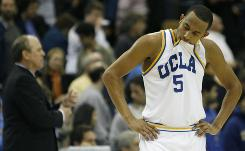 Jerime Anderson reacts as his UCLA Bruins lose to Cal State Fullerton 68-65 in double overtime last Monday in Los Angeles.