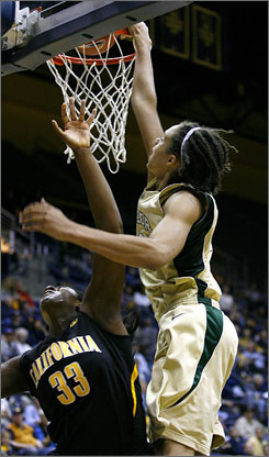 Baylor's Brittney Griner, right, guarded by California's Talia Caldwell, attempts a dunk late in the second half. Though the dunk attempt was unsuccessful, Griner contributed 15 points, seven rebounds and five blocks in Baylor's 69-49 win.
