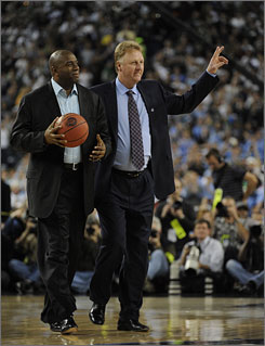 Magic Johnson, left, and Larry Bird bring out the game ball before the start of the semifinal game between Michigan State and North Carolina during the 2009 NCAA Final Four. Johnson and Bird were inducted into the National Collegiate Hall of Fame Sunday night.