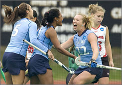North Carolina's Danielle Forword (22) celebrates with teammates Taryn Gjurich, left, and Illse Davids, center, after Forword scored the game-winning goal with 11 seconds remaining.