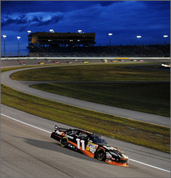 Denny Hamlin shows the way in the late going at Homestead-Miami Speedway.