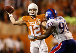 Texas quarterback and Heisman contender Colt McCoy passed for 396 yards and four touchdowns Saturday in a 51-20 win against Kansas.
