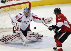 Center Mike Fisher scores the game-winning goal on Capitals goalie Semyon Varlamov in overtime to lead the Senators past the Capitals Monday in Ottawa. The Senators won 4-3 on Fisher's 10th goal of the season.