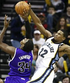 The Memphis Grizzlies' Rudy Gay blocks a shot by the Sacramento Kings' Jason Thompson during the second half of their game in Memphis. The Grizzlies won 116-105.