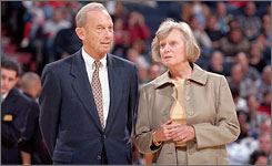 Abe Pollin attends the final game at USAirways Arena, the Wizards' former home, with his wife, Irene, in 1997.