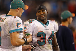 Ricky Williams scored three TDs in his first game since replacing Ronnie Brown as the Dolphins starting tailback.