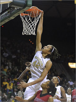 Baylor's Brittney Griner dunks over Jacksonville State's Candice Carmine Tuesday, becoming the seventh woman to dunk in a college basketball game.