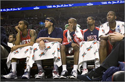 Players on the Nets bench watch during the final moments of their loss to the Trail Blazers.