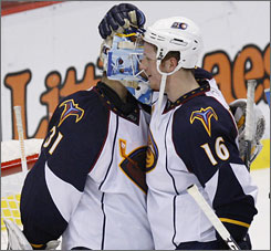 The Thrashers' Christoph Schubert congratulates goalie Ondrej Pavelec after he recorded his second career shutout on Wednesday. Pavelec made 40 saves in Atlanta's 2-0 road win against the Detroit Red Wings.