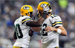 Donald Driver and Aaron Rodgers celebrate after hooking up for a touchdown in the third quarter of Green Bay's 34-12 victory over Detroit.