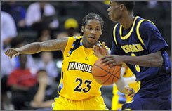 Marquette junior Dwight Buycks guards Michigan's Manny Harris during the Golden Eagles' 14-point victory.