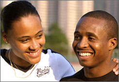 In happier times, Tim Montgomery and Marion Jones shared a smile at a 2002 commercial endorsement photo shoot in Hong Kong.