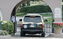 A Florida Highway Patrol vehicle enters the front gate to the Isleworth community where Tiger Woods is a resident Saturday in Windermere, Fla.
