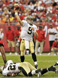 Quarterback Drew Brees and the undefeated New Orleans Saints face the New England Patriots Monday night.