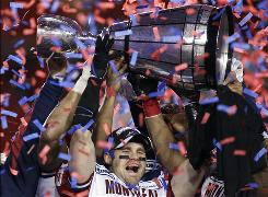 The Montreal Alouettes' Ben Cahoon hoists the Grey Cup after the Alouettes beat the Saskatchewan Roughriders 28-27 to win the Canadian Football League's Grey Cup in Calgary, Canada on Sunday.