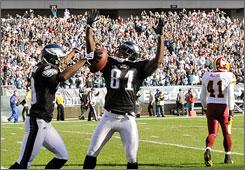 The Eagles' DeSean Jackson, left, and Jason Avant celebrate Jackson's first-quarter touchdown during Philadelphia's 27-24 victory over Washington.