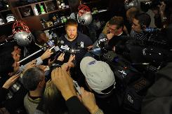 New England Patriots center Dan Koppen faces the increased press attention in anticipation of the Pats' showdown with the undefeated New Orleans Saints on Monday Night Football during media availability at the team's practice facility in Foxborough, Mass., Wednesday.