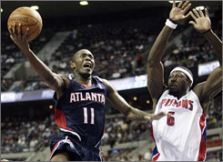 Hawks guard Jamal Crawford tries to drive around Pistons defender Ben Wallace during the first half.