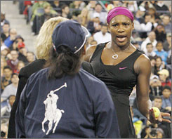 Serena Williams talks loudly to a lineswoman (in jacket with Polo logo) and an official during her U.S. Open semifinal on September 12. The outburst has cost Williams an $82,500 fine.