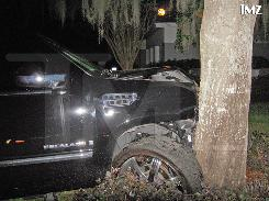 This photo taken Nov. 27, 2009 and provided by the celebrity website TMZ.com shows a Cadillac Escalade that Tiger Woods crashed into a tree outside his home in Windermere, Fla.