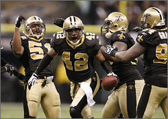 Darren Sharper and the Saints improved to 11-0 with a win against the Patriots on Monday.