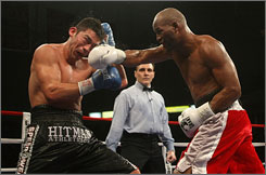 Bernard Hopkins, landing a punch on Enrique Ornelas, improved his record to 50-5-1 with the unanimous decision victory.