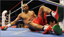 Roy Jones Jr. took an unwanted seat courtesy of Australian Danny Green, who registered a first-round TKO to retain his IBO cruiserweight title in Sydney.
