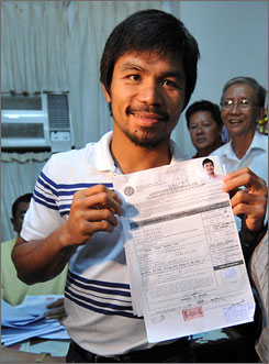 Boxing champ Manny Pacquiao shows the certificate of candidacy for congress which he filed at the provincial capitol in Sarangani province in southern Philippines. Pacquiao will be taking his second jab at politics after his 2007 campaign fell short.