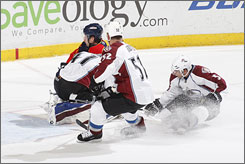 The Panthers' Keith Ballard ran into Avalanche goalie Craig Anderson during the third period of Florida's shootout victory.
