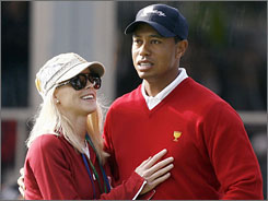 "Tiger Woods, with wife Elin during the Presidents Cup on Oct. 8, said in a statement Wednesday, ""I have been dismayed to realize the full extent of what tabloid scrutiny really means."""