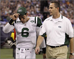 Jets QB Mark Sanchez left the game in the third quarter after injuring his right knee.